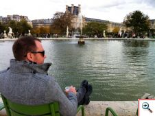 Nick at the fountain by the Louvre