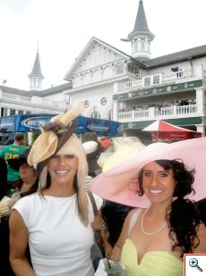 Jenny and Jill in front of the Twin Spires at the Kentucky Derby